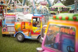 Colorful trucks kiddie ride at fair