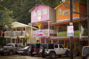 Colorful housefronts with vehicles parked in front