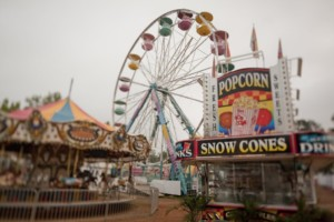 Fair with snow cones booth, carousel and ferris wheel