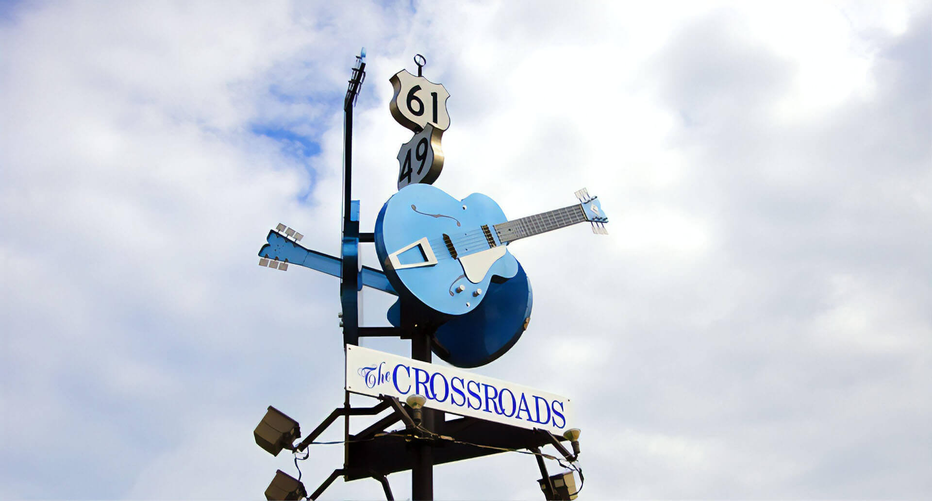 The crossroads sign with blue guitars
