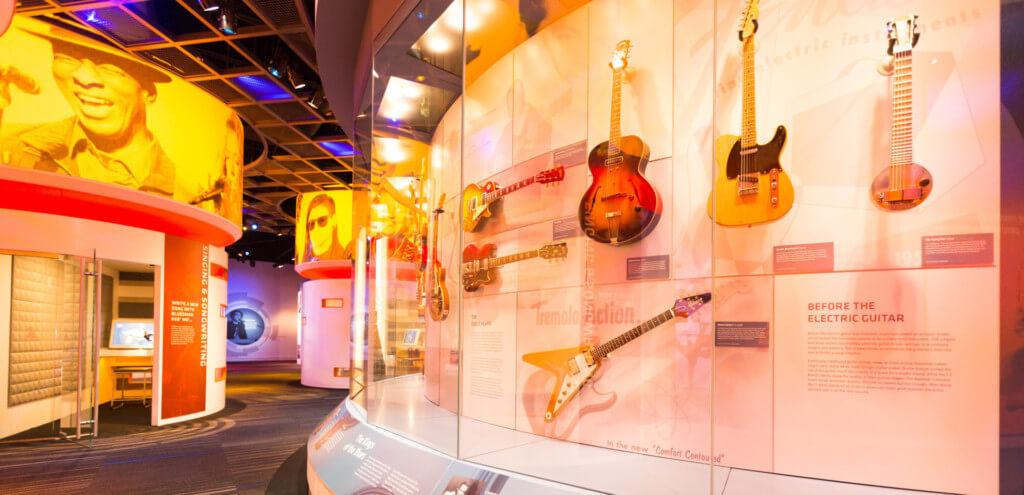 Exhibit of guitar timeline in museum