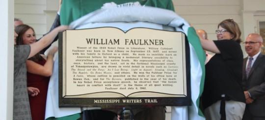 Group unveiling William Faulkner sign