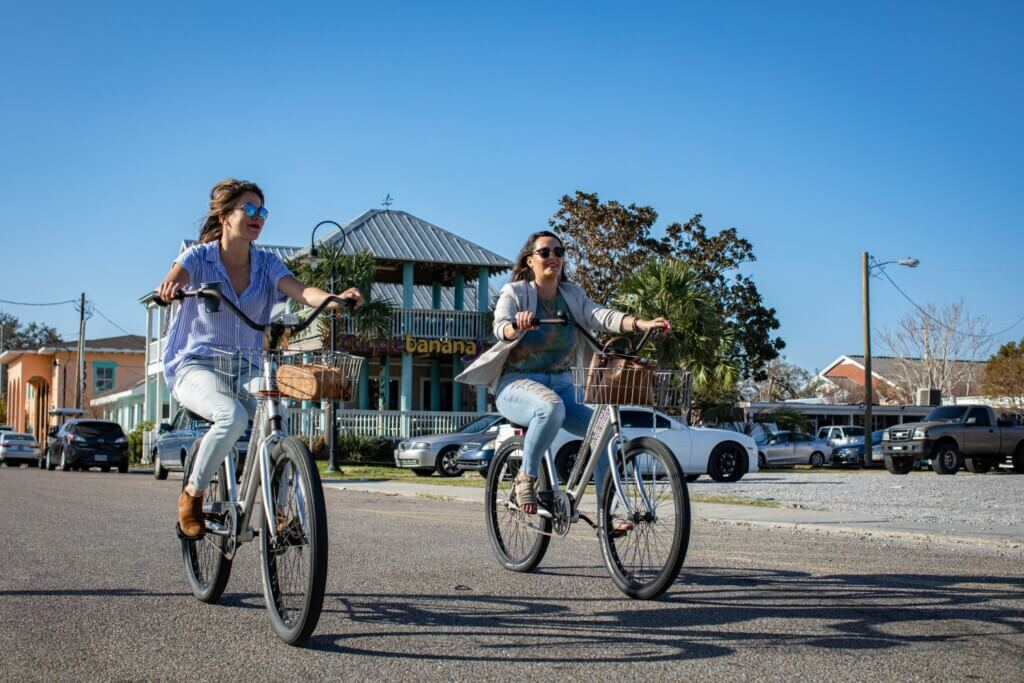 Two women riding bicycles bikes Mississippi Gulf Coast