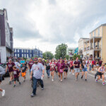 Parade celebrating the Mississippi State Baseball National Championship win passes through the Cotton District.  (photo by Robby Lozano / © Mississippi State University)