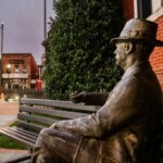 The statue of William Faulkner sits on a bench on the Oxford Square.   Logan Kirkland, Ole Miss Digital Imaging Services.